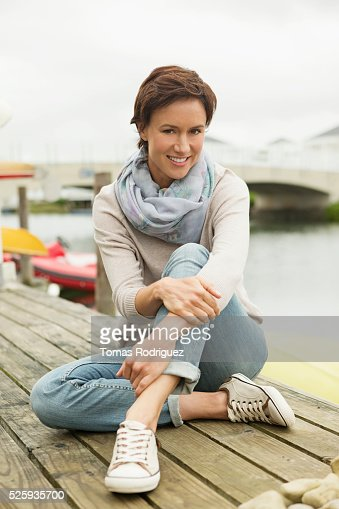 Portrait of woman relaxing on deck : Stock-Foto