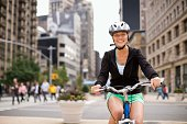 Portrait of woman riding bicycle on city street