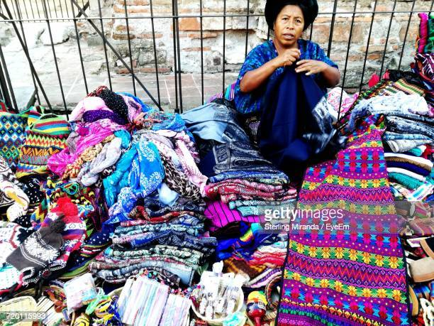 Portrait Of Woman Selling Warm Clothing At Market