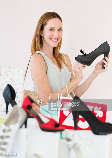 Portrait of woman shopping for shoes