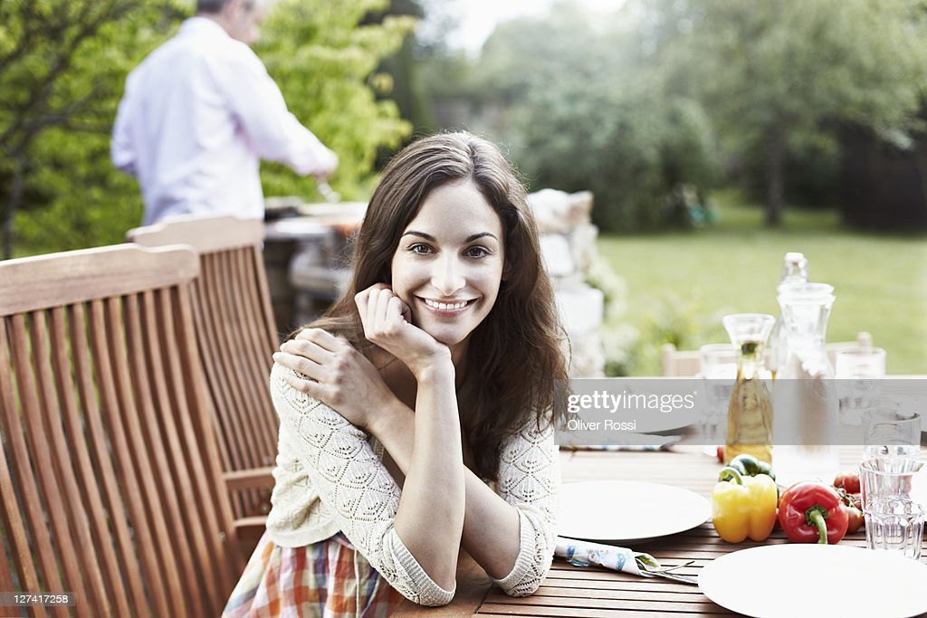 portrait of woman sitting on a table : Stock Photo