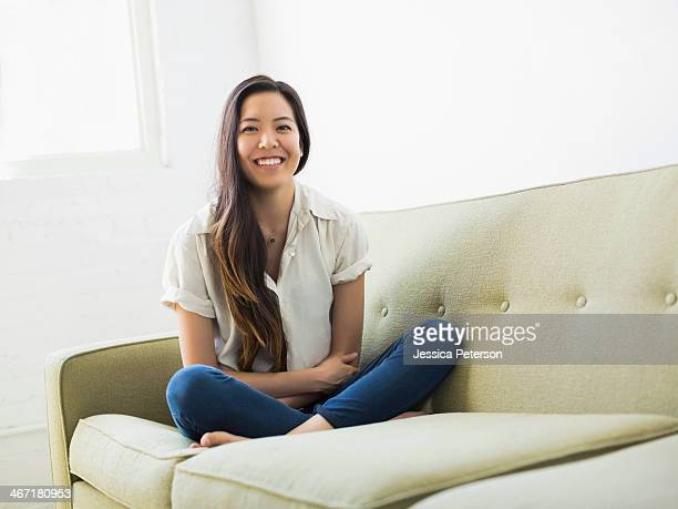 Portrait of woman sitting on sofa