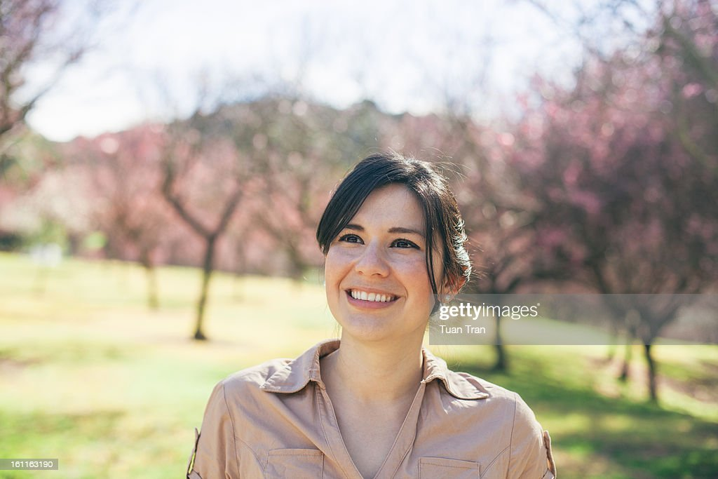 Portrait of woman smiling at the park : Stock Photo