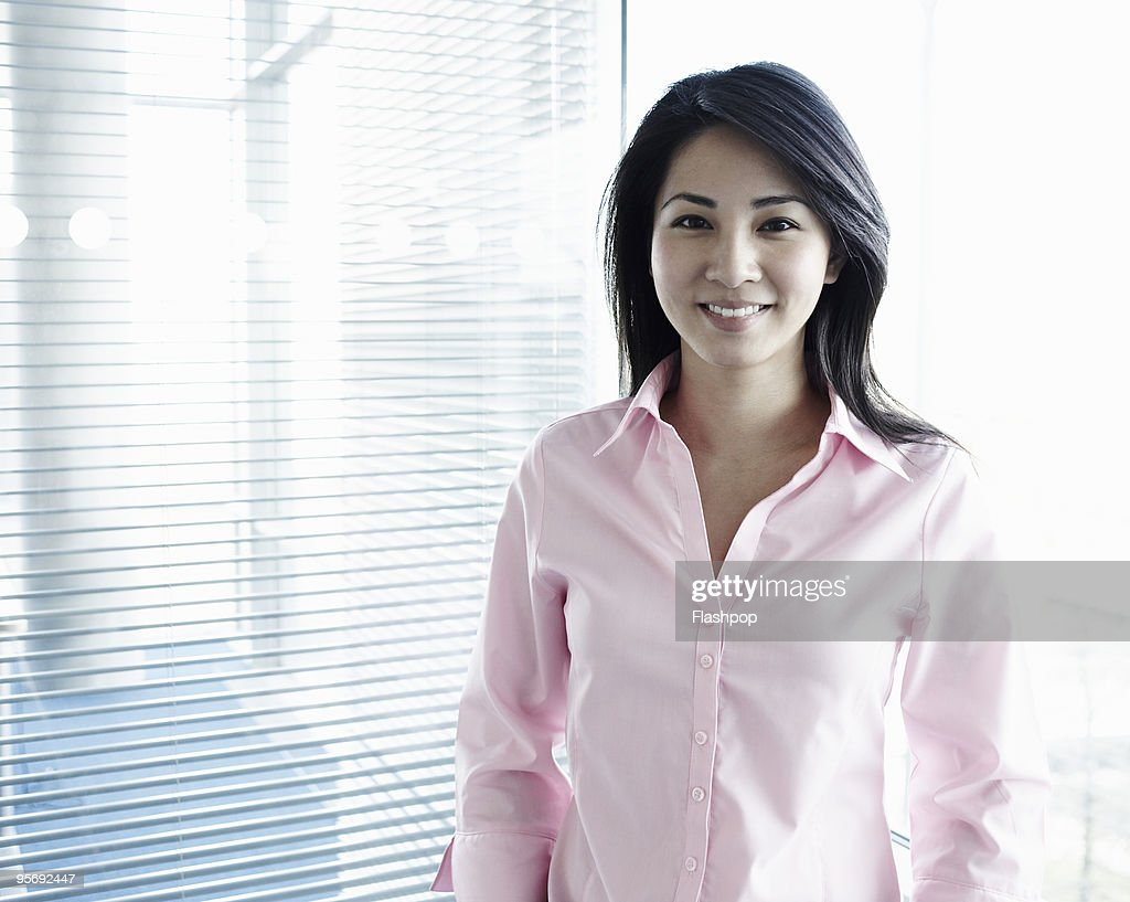 Portrait of woman smiling at work : Stock Photo
