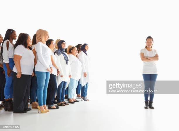 Portrait of woman standing out from the crowd