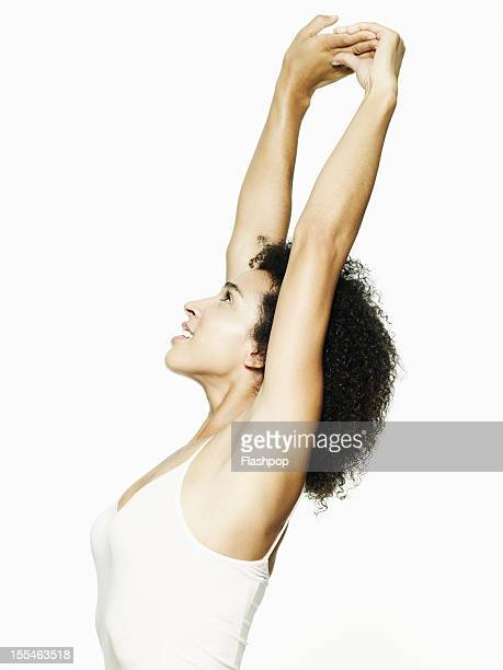 Portrait of woman stretching