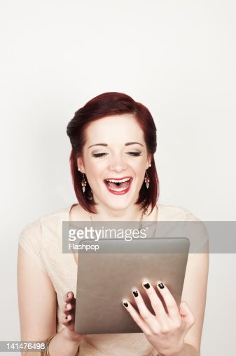 Portrait of woman using digital tablet : Stock Photo