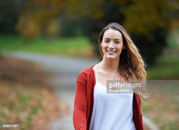 Portrait of woman walking in Autumn park.
