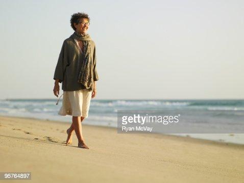 Portrait of woman walking near the sea.