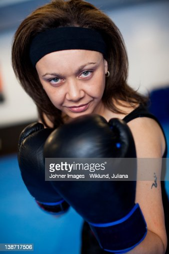 Portrait of woman wearing boxing gloves : Stock Photo