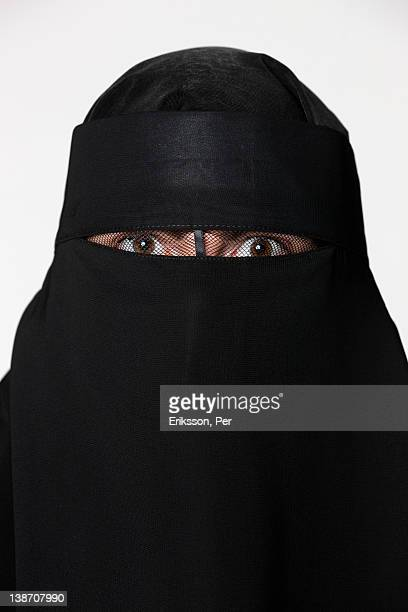 Portrait of woman wearing burka