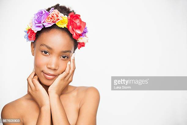 Portrait of woman wearing flower headband looking at camera