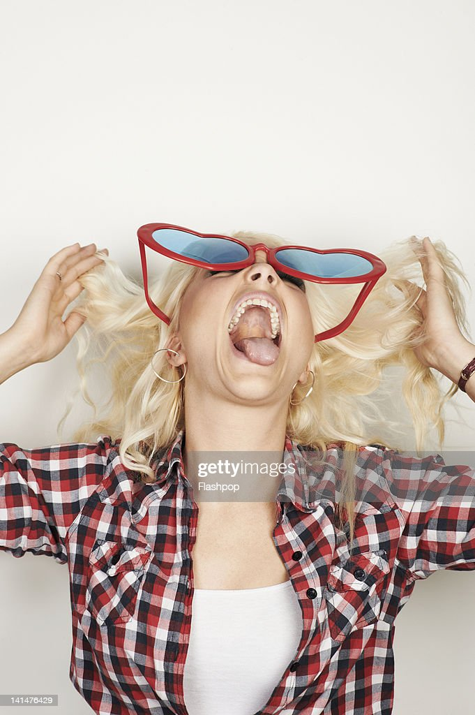Portrait of woman wearing fun sun glasses : Stock Photo