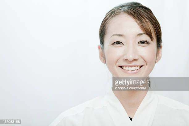 Portrait of woman wearing Kyudo (Japanese art of archery) uniform , Tokyo Prefecture, Japan