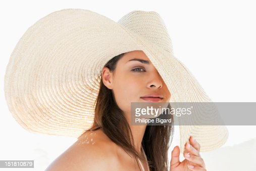 Portrait of woman wearing large sun hat