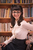 Portrait of woman wearing retro clothing in library