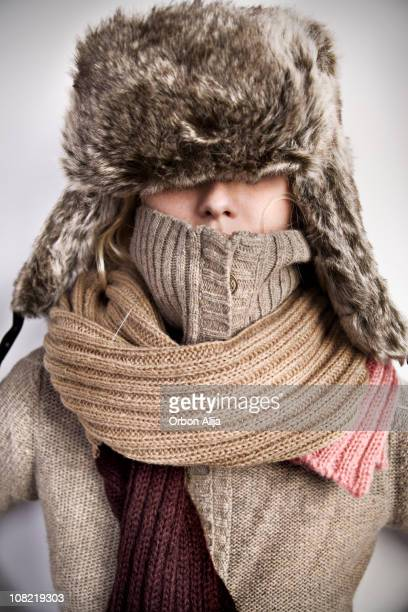 Portrait of Woman Wearing Turtle Neck, Winter Hat and Scarf