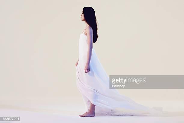 Portrait of woman wearing white