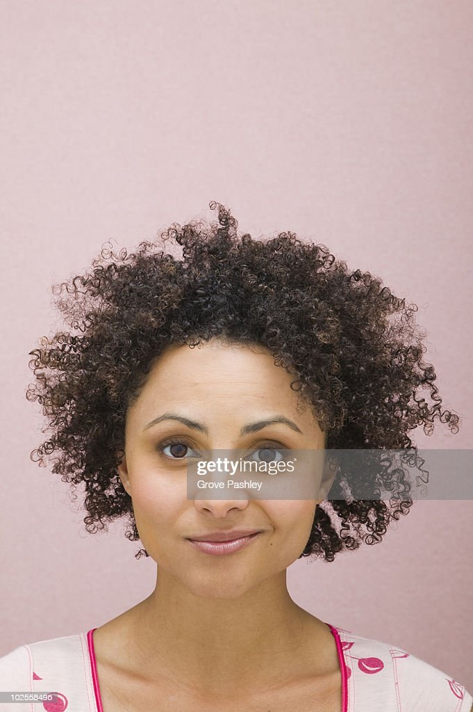 Portrait of woman with a smirk expression. : Stock Photo