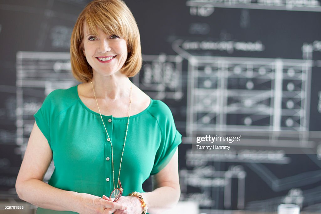 Portrait of woman with architectural design in background : Stock Photo