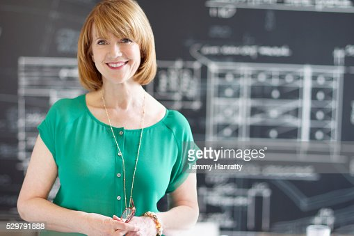 Portrait of woman with architectural design in background : Photo