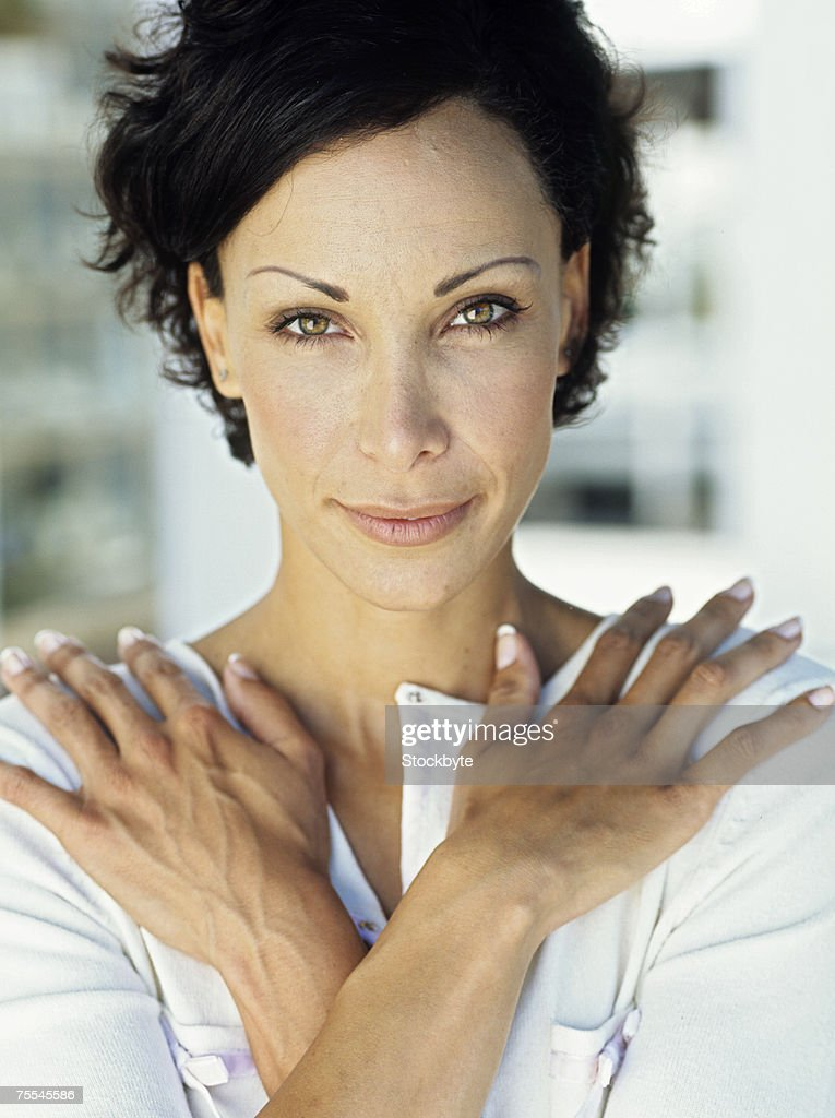 Portrait of woman with arms crossed,outdoors,close up : Stock Photo