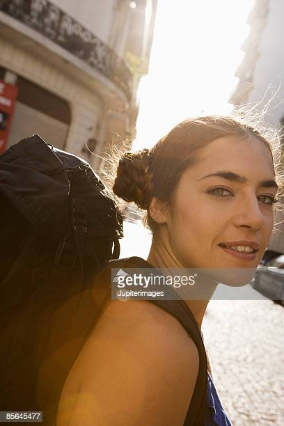 Portrait of woman with backpack in street