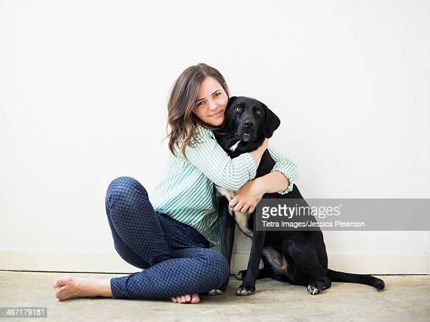 Portrait of woman with black dog
