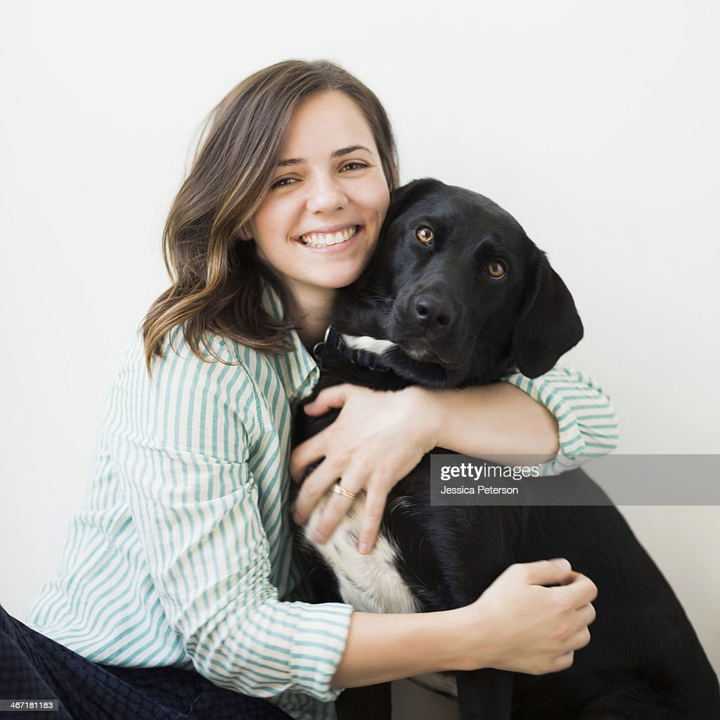 Portrait of woman with black dog : Stock Photo