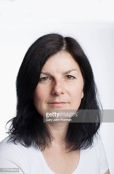 portrait of woman with black hair against white ba