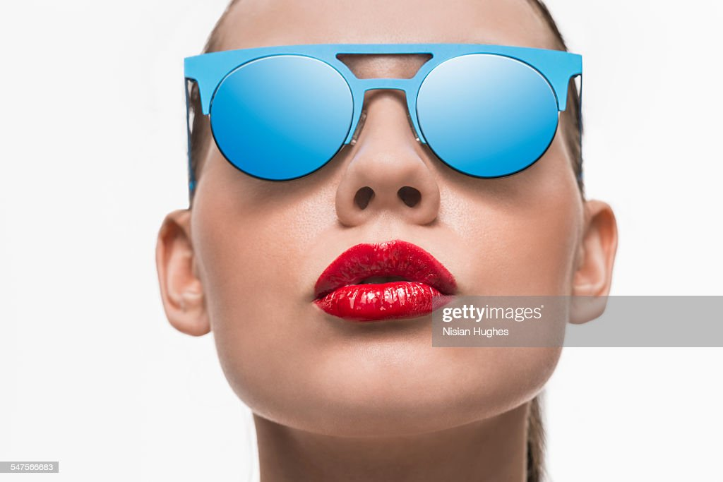 Portrait of woman with blue sunglasses : Stock Photo