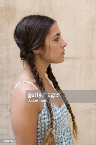 Portrait of woman with braided hair : Stock Photo