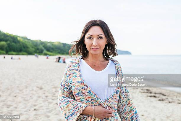 Portrait of woman with brown hair on beach