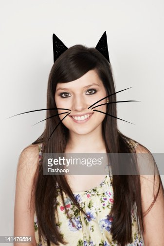 Portrait of woman with cat ears and whiskers : Stock Photo