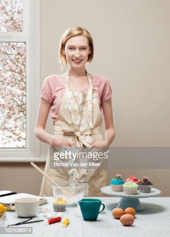 woman decorating cupcakes stock photo getty images - Woman Decorating Cupcakes