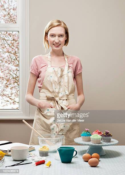 portrait of woman with cupcakes.