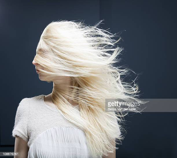 portrait of woman with face covered in hair.