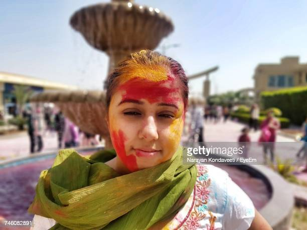Portrait Of Woman With Face Powder During Holi Outdoors
