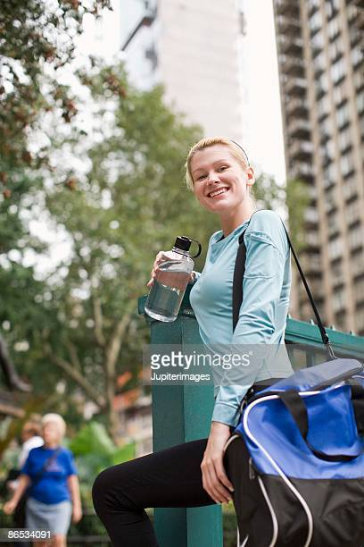 Portrait of woman with gym bag outdoors