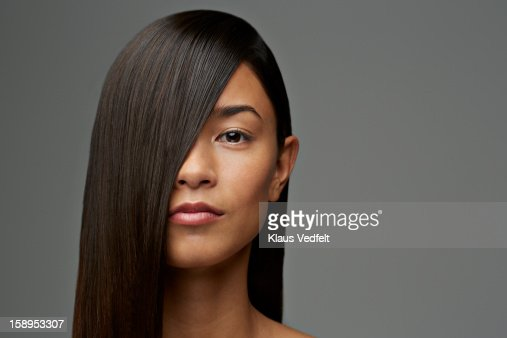 Portrait of woman with hair covering half the face : Stock Photo