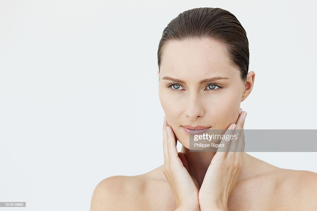 Portrait of woman with head in hands : Stock Photo