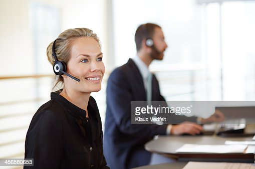 Portrait of woman with headset doing phone support
