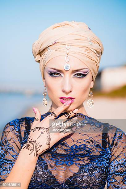 Portrait of woman with henna tatoos in sunrise lights