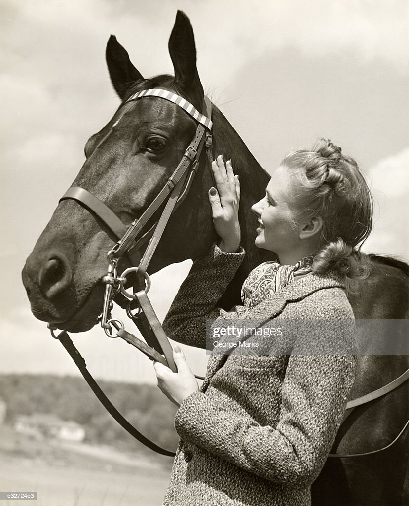 Portrait of woman with her horse : Stock Photo