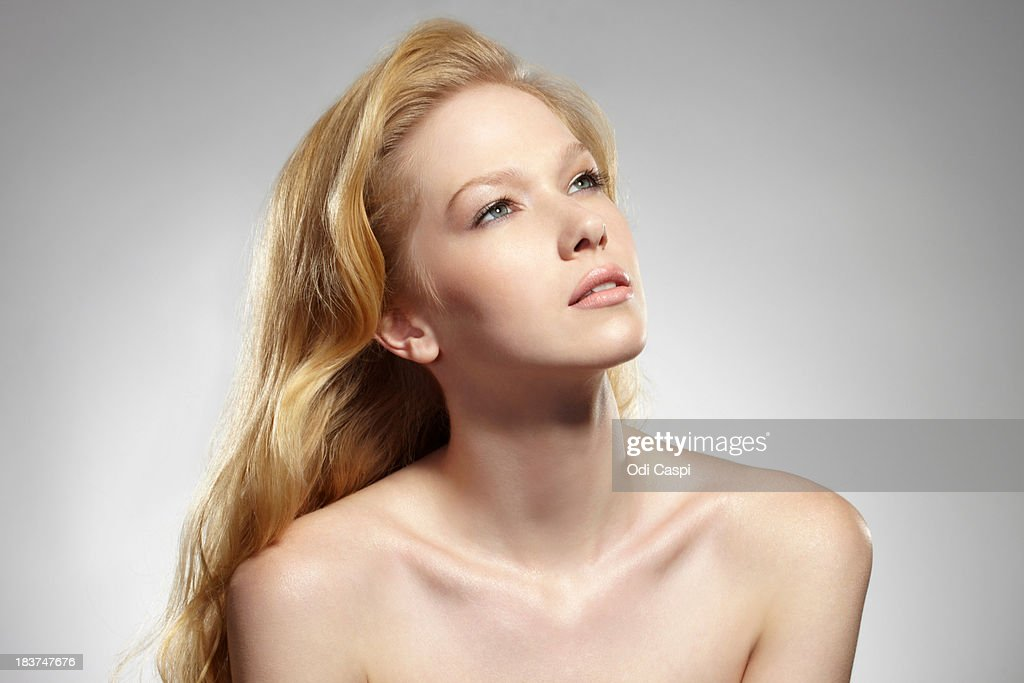 Portrait of woman with long blonde hair : Stock Photo