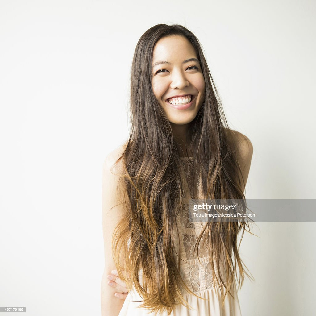 Portrait of woman with long brown hair : Stock Photo