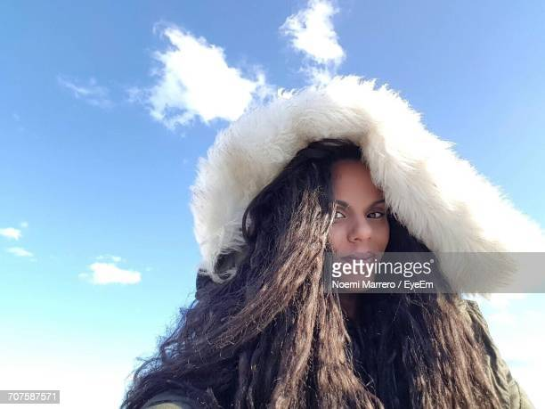 Portrait Of Woman With Long Hair Against Sky