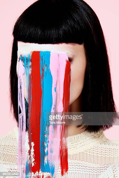 portrait of woman with paint on face