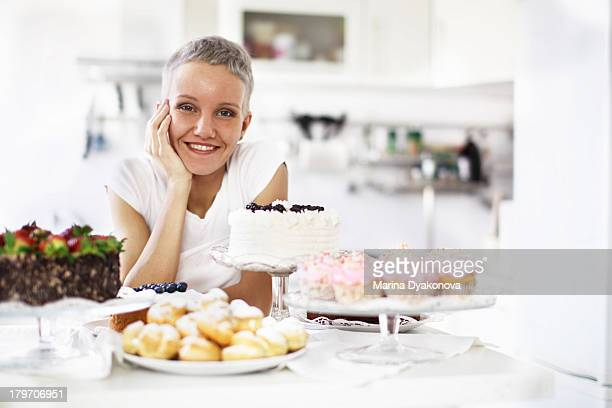 Portrait of woman with selection of hand made cakes