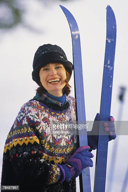 Portrait of woman with snow skis